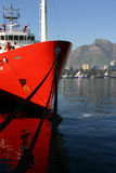 Red ship in Table bay. Red ship docked at Table bay royalty free stock images