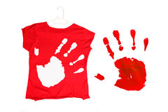 Red shirt with hand. Red shirt on hanger with white hand print. Red hand print on white background stock images
