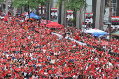 Red-Shirt Protest in Bangkok. An estimated 30,000 red-shirt protesters gather at Ratchaprasong Junction to remember those killed in political violence in the Royalty Free Stock Images