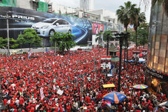 Red-Shirt Protest in Bangkok. An estimated 30,000 red-shirt protesters gather at Ratchaprasong Junction to remember those killed in political violence in the Stock Images