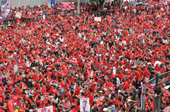 Red-Shirt Protest in Bangkok. An estimated 30,000 red-shirt protesters gather at Ratchaprasong Junction to remember those killed in political violence in the Royalty Free Stock Photos