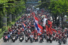 Red Shirt Protest. A convey of red shirt protesters rally through central Bangkok on their way to a protest outside the Thai Parliament on May 8, 2013 in Bangkok Royalty Free Stock Photography