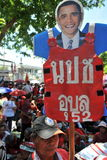Red Shirt Protest. A man holds a sign claiming support from President Barack Obama while attending a red shirt protest outside the Thai Parliament on May 8, 2013 Royalty Free Stock Photos