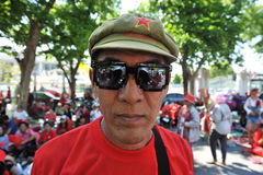 Red Shirt Protest. A man joins a red shirt protest outside the Thai Parliament on May 8, 2013 in Bangkok, Thailand. The approximately 3,000 protesters gathered Royalty Free Stock Photos
