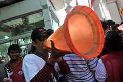Red Shirt Protest. A man uses a traffic cone to direct a red shirt protest outside the Thai Parliament on May 8, 2013 in Bangkok, Thailand. The approximately 3 Stock Photos