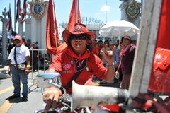 Red Shirt Protest. A red shirt protester on a motorbike joins a rally outside the Thai Parliament on May 8, 2013 in Bangkok, Thailand. The approximately 3,000 Stock Photo