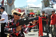 Red Shirt Protest. A woman holds a toy gun while attending a red shirt protest outside the Thai Parliament on May 8, 2013 in Bangkok, Thailand. The approximately Stock Photography