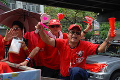 Red SHirt Protestors with Heart Clappers Royalty Free Stock Photo