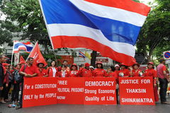 Red Shirt Rally in Bangkok. Red Shirt protesters rally at Democracy Monument outling their political objectives and in remembrance of violent clashes that Stock Photo