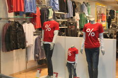 Red shirts. On showcase models in store near Bucharest,Romania Royalty Free Stock Photo