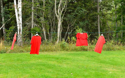 Red shirts on clothesline Royalty Free Stock Photography
