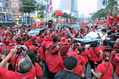 Red Shirts Protest in Central Bangkok. BANGKOK - DECEMBER 19: An estimated 10,000 anti government Red Shirts defy an emergency decree to protest at Rachaprasong Stock Photography