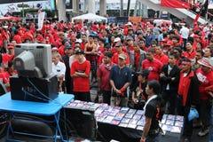 Red-shirts watching a video at a rally in Bangkok stock photos