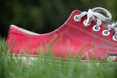 Red shoe. Close up of a red shoe, worn and well used Stock Photography