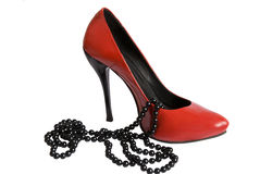 Red shoe and black beads. Isolated on white background Stock Photo