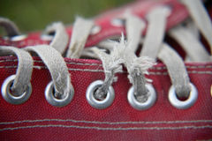 Red shoe close-up. Close-up shot of worn-out laces on a red shoe Royalty Free Stock Images