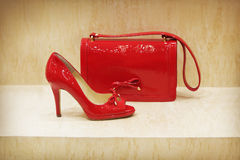 Red shoe and bag. Red shoe and clutch bag royalty free stock photo