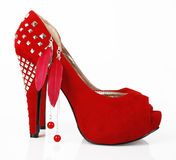 Red shoe and earrings. On a white background royalty free stock photography