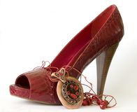 Red shoe with high heel and necklace royalty free stock photo