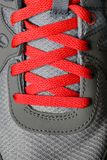 Red Shoe Laces on Running Shoes. Detail of red shoe laces on running shoes Royalty Free Stock Photography