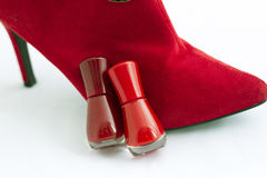Red shoe and nail polish Stock Images