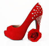 Red shoe and rose. On a whine background royalty free stock photos