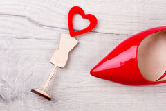 Red shoe and small heart. Little heart on stand. Fashion in little details. Style of love day Stock Photos