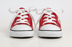 Red Shoe / Sneakers isolated on white. A pair of new red canvas shoe isolated on white Stock Photos