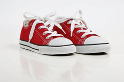 Red Shoe / Sneakers isolated on white. A pair of new red canvas shoe isolated on white with soft reflection Stock Photo