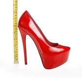 Red shoe and tape measure. On a white background stock photo
