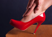 Red shoe. Red woman's shoe on high heel Stock Image