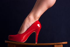 Red shoe. Red woman's shoe on high heel Royalty Free Stock Photography