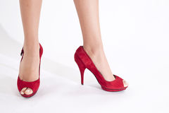 Red shoes. Walking with heeled red shoes by 15 cm royalty free stock photo