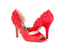 Red shoes. Red high heels pump shoes on white background Stock Image