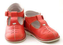 Red shoes. Childrens shoes isolated on white Royalty Free Stock Images