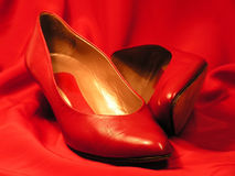 Red shoes. With red background Stock Images