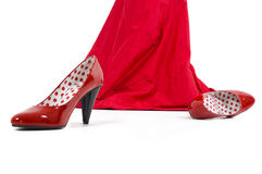 Red shoes. Shiny red high hill shoes.Girl in red with red shoes Stock Image