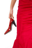 Red shoes. Shiny red high hill shoes.Girl in red with red shoes Stock Photography