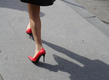 Red shoes. Woman with red shoes walking Royalty Free Stock Photo