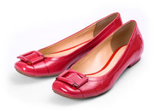 Red shoes. Shiny red shoes against a white background royalty free stock photo