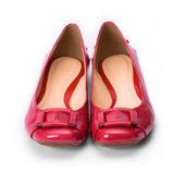 Red shoes. Shiny red shoes against a white background Royalty Free Stock Image