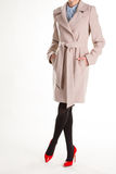 Red shoes and beige coat. stock images
