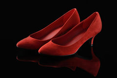 Red shoes on a black background Stock Image