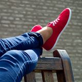Red shoes and blue denim Stock Photos