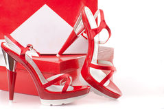 Red shoes with boxes Stock Images