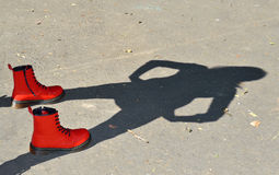 Red shoes and child shadow.  Stock Image