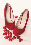 Red shoes and chocolate hearts for Valentine Royalty Free Stock Photos