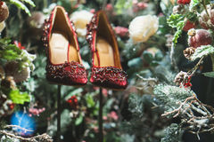 Red shoes in Christmas tree, snow and decorations. Snow and decorations and red shoes in Christmas tree Stock Photography