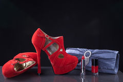 Red shoes and a clutch Royalty Free Stock Photos