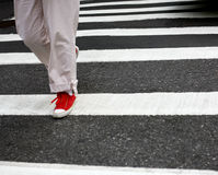 Red shoes on crosswalk Royalty Free Stock Photos